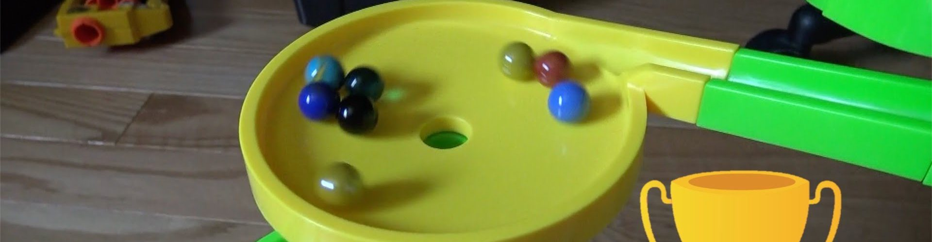 Marbles racing through a funnel